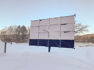 The solar panel collected snow yesterday; Andy wiped some clean last night.