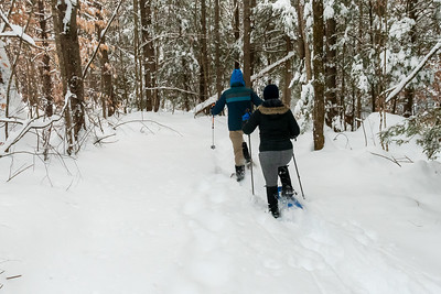 Andy and Mara snowshoe on the trail around Crossroads in Lyme.