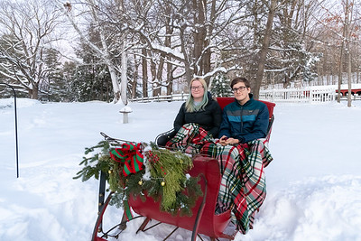 Mara and Andy in an antique sleigh in Lyme NH.