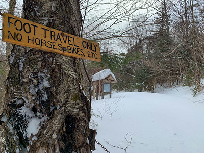 The trails are unbroken beyond the end of the plowed access road at Moosilauke Ravine Lodge.