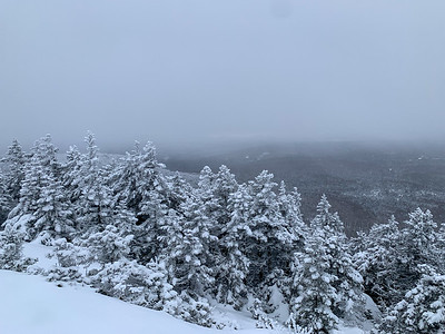 When we reach the summit of Black Mountain, the clouds have obscured Mount Moosilauke.