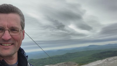 David on the summit of Mount Cardigan on a very windy day!