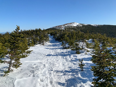First good view of the summit, from the ridge crossing. The windswept west face is nearly clear of snow.
