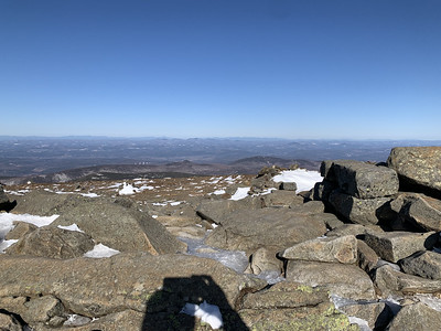Looking west across Vermont, with Camels Hump at center, Mount Mansfield's snowy ski trails to the right (but hard to spot), and (in several places) the Adirondacks peeking out beyond the Green Mountains.