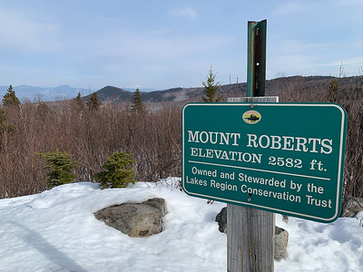 The summit of Mount Roberts includes grand views of the White Mountains, including Mount Washington in the center distance.
