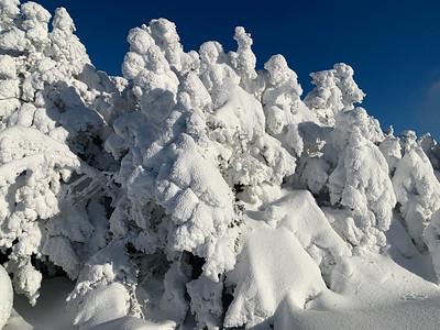 The summit of Pico Peak is deep in snow.