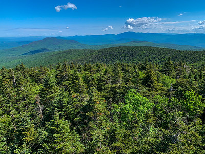 View northeast from Smarts Mountain, toward Mount Cube and Mount Moosilauke and the White Mountains beyond.