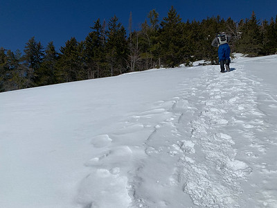 Andy traverses the giant granite slab on Mount Welch.