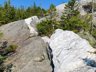 The incredibly white, large vein of quartz (marble?) passing through the granite ledges.