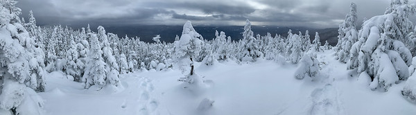 Panoramic view from the summit of Worcester Mountain.  The ascent trail is at center left and a viewpoint is at right.