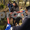 Mariam Rizvi, center, and Karthika Venugopalan, right, trim a small tree at Mercy Ships' headquarters in Garden Valley, Texas, on Wednesday, March 14, 2018. The students volunteering are part of a group of about one hundred taking part in the Alternative Spring Break program offered by UT Dallas, which helps students learn leadership skills and focuses on social issues.  (Chelsea Purgahn/Tyler Morning Telegraph)