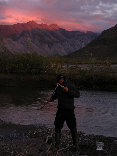 Trystan enjoys the last bit of his grayling on a lovely evening.