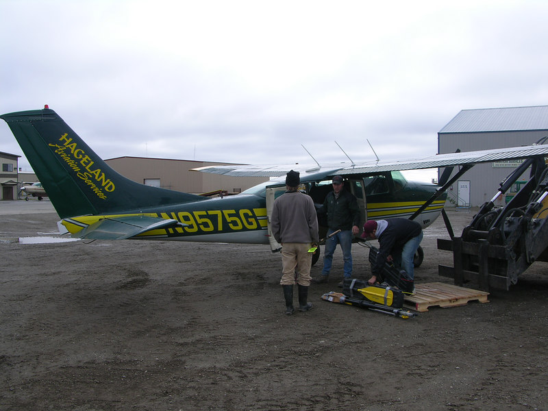 Ian standing by as pilot Eric Sieh loads the Cessna 206 with our gear.  The plane comfortably seated three (pilot included) and our nearly 500 pounds of food and gear.