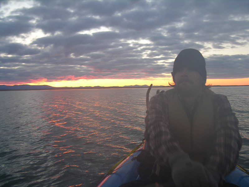 A big sigh of relief and wonder. A beautiful sunrise and optimum crossing conditions. Such was not guaranteed. We had heard stories of people waiting for hours to days before winds abated enough to allow safe passage from the river's mouth to Kotzebue. We sailed smoothly through the pinks and oranges and purples and yellows.