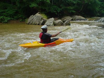 Surfing upstream on the Sanp Falls, Muddy Creek