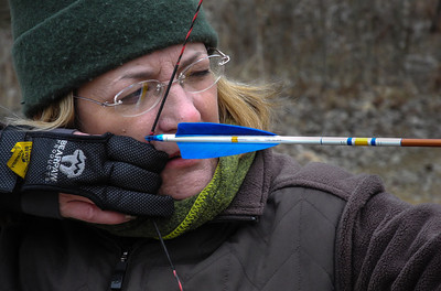 Barb takes aim with one of her new Go Blue! arrows at Tuscola County Archers.