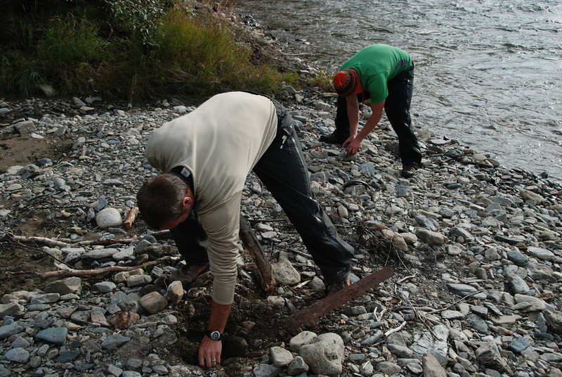 With time to relax, Nick cleans fresh-caught grayling and Devan decided to remove a saw we had discovered in aggraded flood gravels near Camp 3&4.