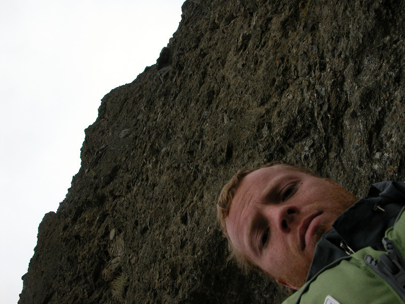 A self-portrait, with a nearly overhanging cliff along the river looming overhead.