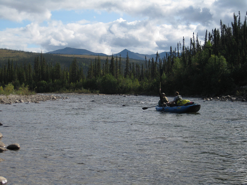 Pat holds up his paddle in victory, with nearly one river mile under our belts.  NIck quickly gained his bearings with the oars...a four mile float through Fairbanks the previous day was all the preparation he had prior to embarking on the mighty Charley!