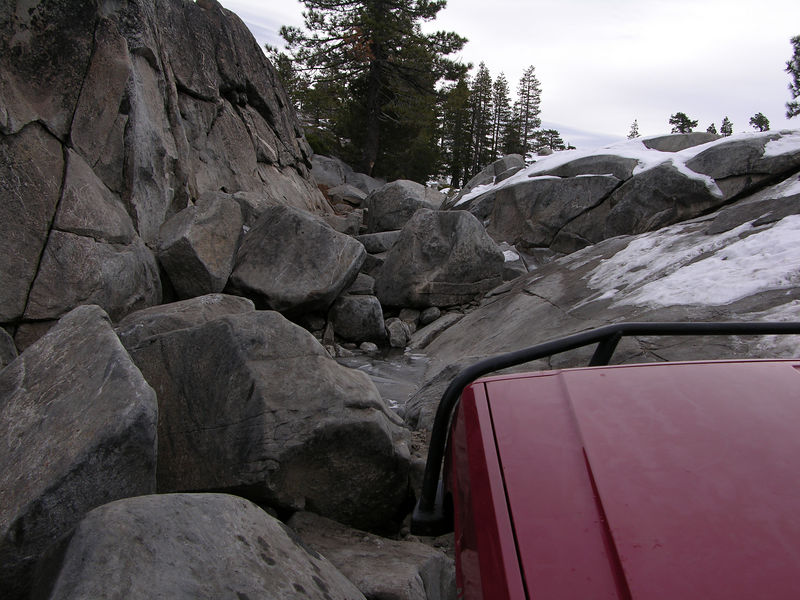 A typical view from the driver's seat consists of the hood and the trail about 15 feet ahead.
