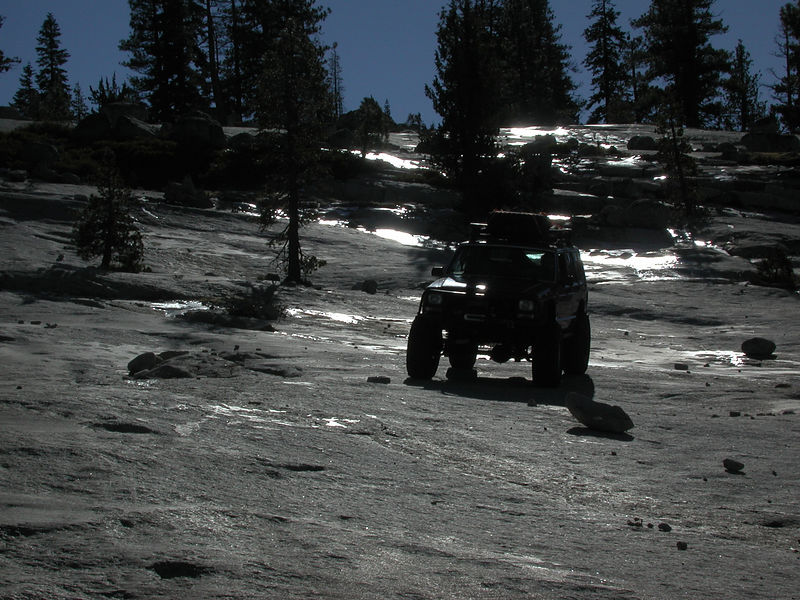 View from the bottom of Granite Bowl.  This is a good point to explain the two types of trail encountered on the Rubicon.  The first type being slab, as seen in this photo.  Slab portions of the trail are wide open and your route from A to B is not well defined.  The other type of trail is the well defined, forested sections where your route from A to B is through a vehicle wide swath in the trees.  Photos near Gate Keeper well portray this latter type of trial.