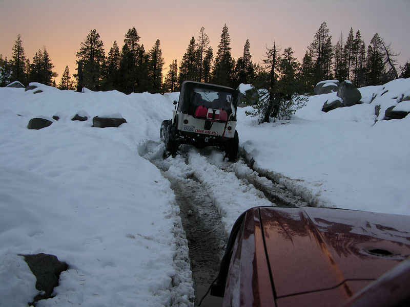 As we wheeled into the night we slowly made headway towards the Loon Lake trailhead.  As a testimony for how easy this section of trail was, I used my winch twice after we meet the search and rescue folks, whereas on the six or so miles between Cadillac Hill and Spider Lake we likely winched 80 to 100 times.  <br />      <br /> A few hours after dark  on Monday evening we were at the trailhead.  I quickly inspected my rig and made a few steering adjustments while Pat and Ian aired up the tires.  I thanked the crew chief for his time and effort and signed the necessary search and rescue paperwork that one county needed in order to bill another county for the man hours invested.  The rescue mission was clearly not deployed as a result of our gross negligence and therefore we would not be held financially responsible for the mission.  It is unfortunate that the team had to be deployed, but everyone involved did what they had had to do as mother nature, with complete indifference, brought winter into the Sierra in full force.  <br />      <br /> We were on the road heading home by about 9 or 10 PM and Ian, Pat, and myself were sleeping soundly in our own beds by 1:30 AM on Tuesday morning.<br /> <br />      I have here attempted to give an accurate account of our Rubicon endeavors, but it is insufficient.  We were prepared for the unexpected and the unexpected did in fact happen.  The storm that single handedly generated the less that desirable predicament we found ourselves in at the top of Cadillac Hill was all but overlooked by the weatherman when we left on Thursday afternoon.  A 10% chance of precipitation on Sunday afternoon was the only blemish on days upon days of forecasted blue skies.  Nevertheless, being mentally and physically prepared for the unimaginable always gives one an edge when that somewhat unimaginable scenario rears its ugly head at the least opportune moment.