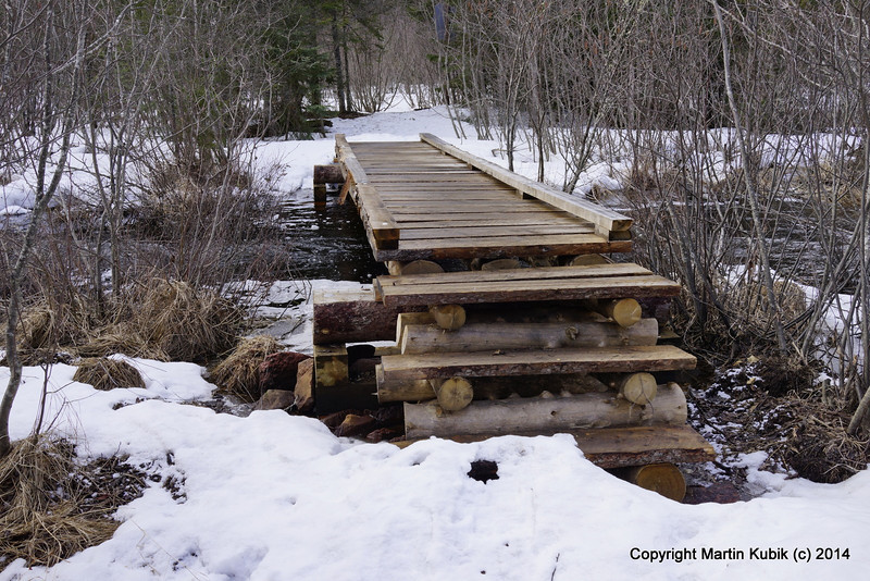 US Forest Service built this crossing in summer 2013.  It should last quite a while and it will not wash out like the old board walk.  Thank you USFS.