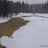Brown water is sign of spring coming - looking upstream.