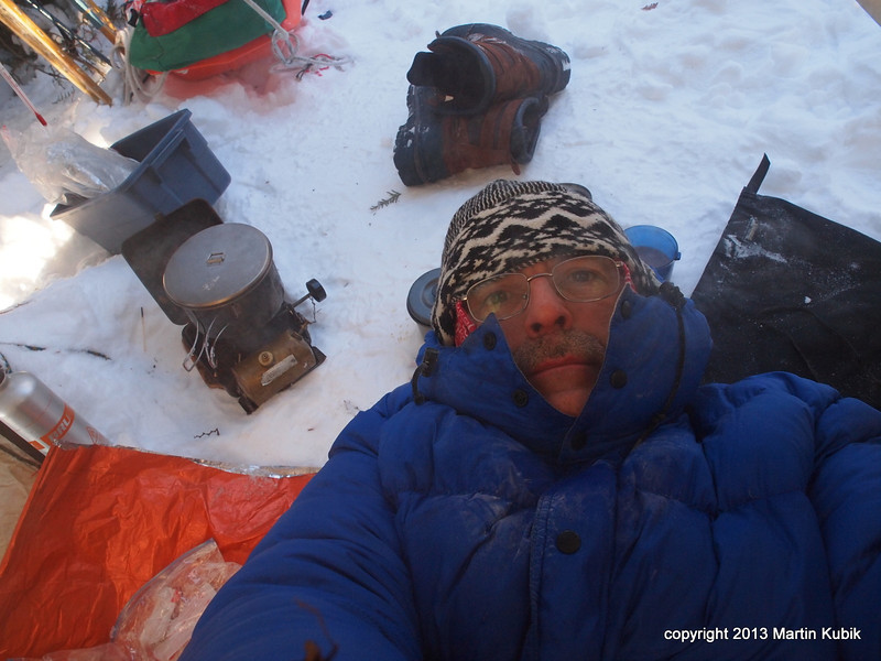At minus 18 deg F, I just don't seem to be able to squeeze a smile for the camera.  We cook breakfast while still in the sleeping bag to conserve body heat.  to the left is the old, reliable Optimus 111B expedition stove.   I felt pretty comfortable, but for whatever reason, it does not show in pictures.