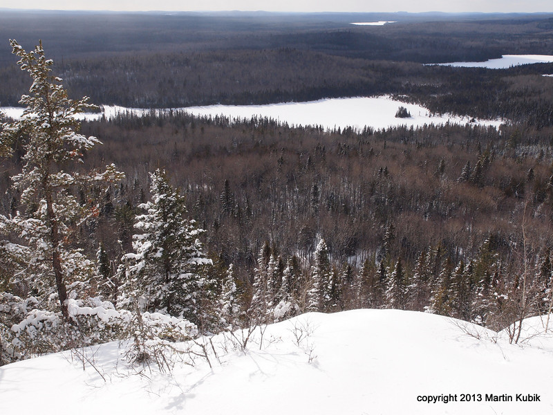 """View of the """"Czech Direct"""" route from top to the penninsula on Shrike Lake.  Coming from the point requires trudging in deep snow, breaking through air pockets and steep assault to the top in the end.  This route has left many a mountaineer in tears."""