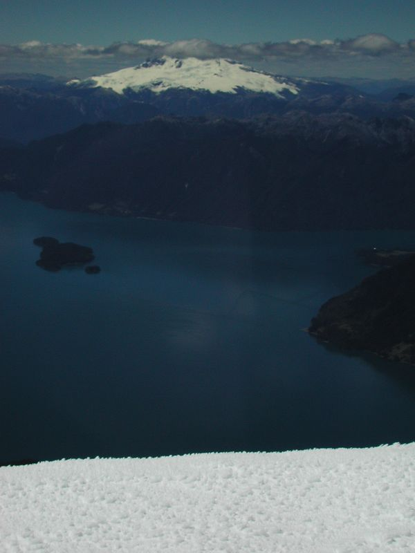 View of Volcan Tronador from the summit of Osorno.  The Argentine-Chilean border runs across the peak of this mountain.  Lago Todos los Santos is in the mid-ground.
