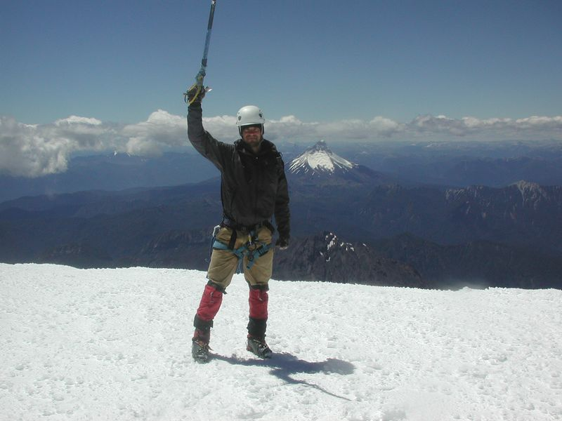 Trystan on the summit with Volcan Puntiagudo in the background.