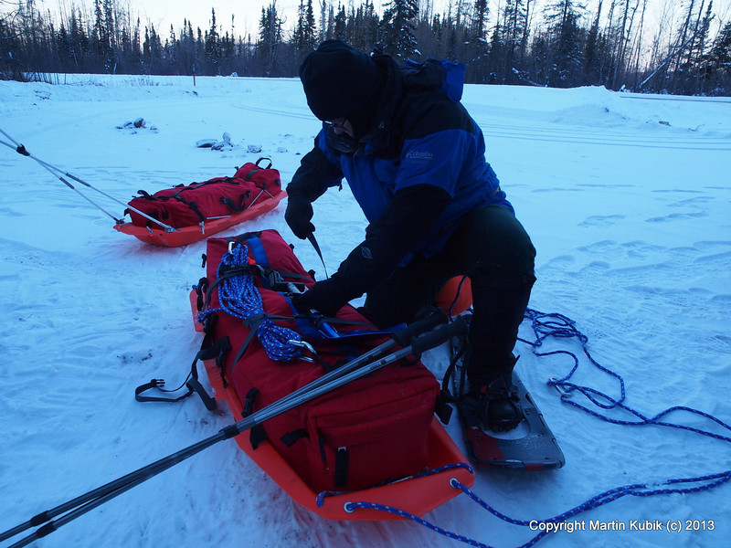 """Brian cinches the final strap.  These two sled bags were made by Cooke Custom Sewing, <a href=""""http://www.cookecustomsewing.com/"""">http://www.cookecustomsewing.com/</a> and feature heavy duty zippers and 3M Thinsulate (TM) insulated water bottle compartment."""