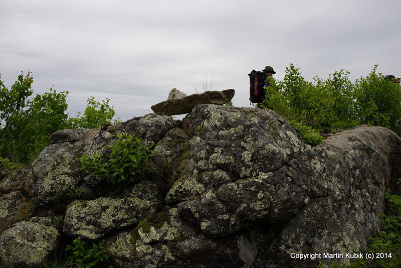 """This used to be a nice rock cairn but some one did not like it, or perhaps a bear vandal or ??? See what is used to look like at 2009 May Kek trail clearing elsewhere on  <a href=""""http://www.bwac.smugmug.com"""">http://www.bwac.smugmug.com</a>"""