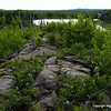 The long ridge above War Club Lake, facing west with Seahorse Lake in the distant past.   If you have just passed by 38 rock cairns amassed in fewer than 50 yards, you will be at this spot.  Question:  Why are there 30 rock cairns in 50 yards?