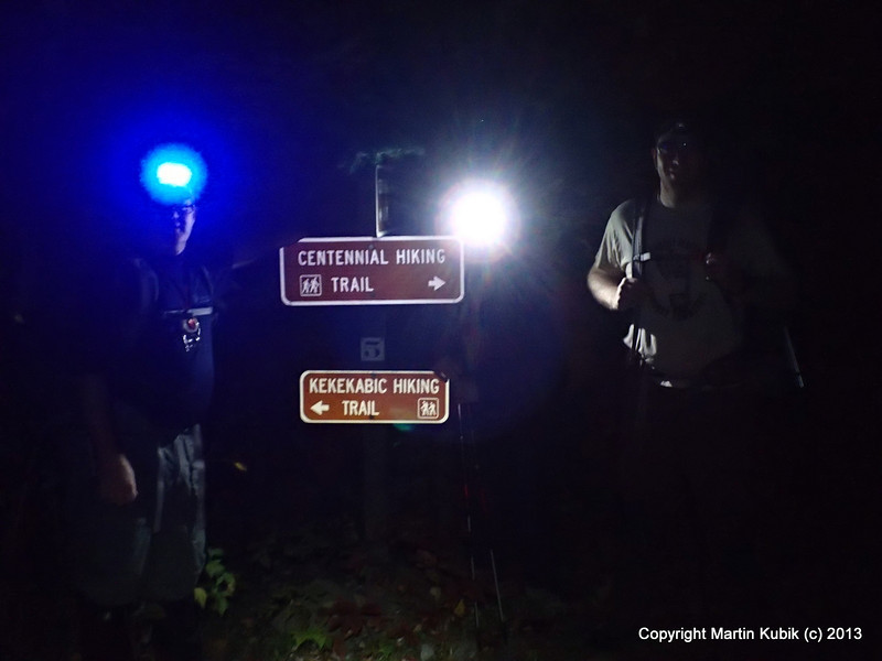 We start hiking at dusk - part of the training routine.  The trail to Bingshick Lake, about 3.5 miles is fairly benign.  The designers must have known about our passion for night time forays - and installed reflective highway like signs.