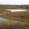 """Spotting the """"Diamond"""" called so because of its shape, from the ridge with 38 rock cairns in fewer than 50 yards.  Below is the Chub River leading to War Club Lake."""