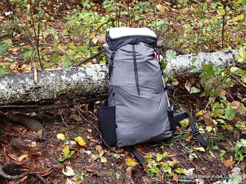 My new pack performed admirably.  Made out of fabric with Dyneema fibers it is highly rip resistant, yet it weighs only 1 pound and 5 ounces.  It features deep water bottle pocket on left and shorter pocket for handy access to small ziplock of Gorp on the right.