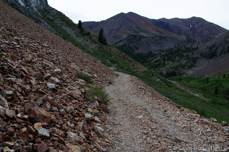 The trail was right up against the rocky side of the mountain.
