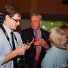 Mark Privratsky, Congressman's Rick Nolan's staff, examining the award from NCTA.