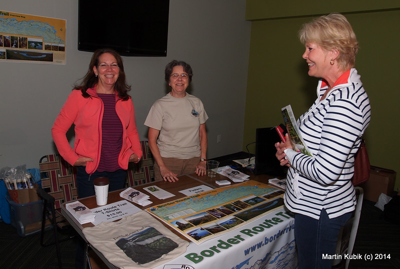 How do you spell enthusiasm?  B-R-T-A!   Border Route Trail Association maintains Border Route Trail. Lori Gilbertson and Deena Reisman at the booth are recruiting an obviously unsuspecting volunteer ( who was kind enough to turn and smile for this unstaged photo).