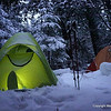 We set up camp last night about 9 PM.  It snowed on and off all night.  We woke up to about 6 inches of new snow.  That will make travel a bit more challenging, but the snow is fairly dry and light.