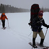 "Scott is leading the team at ""Inverted T"" pond while the snow is coming down."