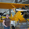 "Meaghan next to the ""Yellow Peril"" bi-plane."