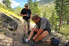 """Nick tending to his feet as we climb an """"interminable slope"""" in 80+ degree heat."""