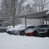 Our cars all covered in snow.