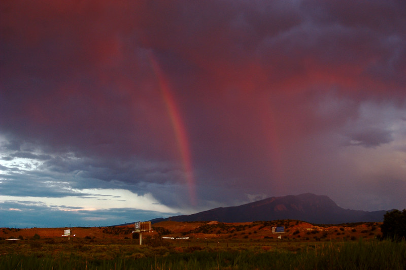 <center><h1> Rainbow Sunset</h1></center>  Mother Nature pulled out the stops for this July 4th Sunset. Watermelon tinted Rainbows in front of Sandia Mountain was her grand finale.