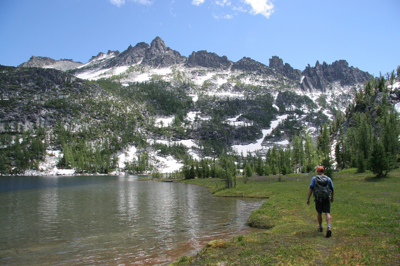 Bill hikes along the beautiful shores of Shield Lake, with the backside of The Temple in view.