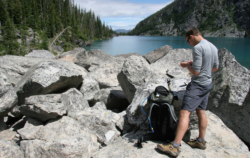Taking a break before heading up Aasgard, enjoying the view of Colchuck Lake.