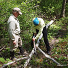 Rod and Jan get to work.   Small branches can be cut quickly with loppers, and then bow saw takes over.